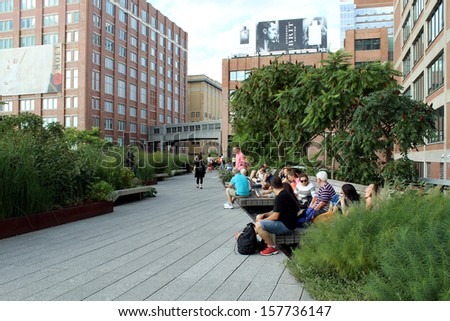 NEW YORK CITY - SEPTEMBER 03: People at High Line Park in NYC on September 03th, 2013. High Line is a public park built on an historic rail line elevated above the streets on Manhattan West Side.      - stock photo