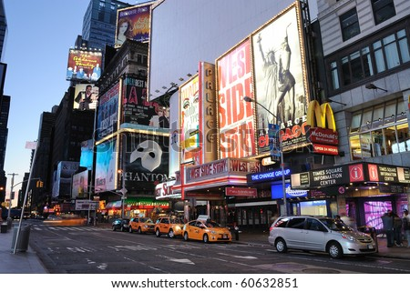 NEW YORK CITY - SEPTEMBER 5: Theater billboards are the trademark of Times Square September 5, 2010 in Times Square New York, New York. - stock photo