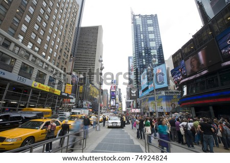 NEW YORK CITY - SEPTEMBER 19: Times Square in New York City on September 19 ,2010. Times Square attracts an estimated 26 million annual visitors each year. - stock photo
