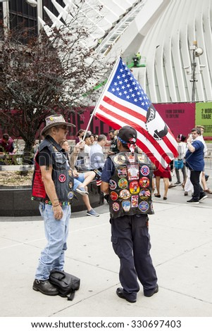 new york city, 11 september 2015: two patriots near ground zero with flag in new york city demonstrate in remembrance of 9-11 - stock photo