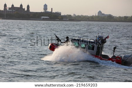 NEW YORK CITY - SEPTEMBER 10 2014: US Coast Guard Response Boat Small Class patrolling New York Harbor just past Ellis Island. The RB-S is noted for  maneuverability with a top speed over 40 knots. - stock photo