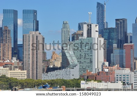 NEW YORK CITY - SEPTEMBER 8: View of Manhattan, as seen on September 8, 2013. New York is the largest city by population in the USA and has millions of yearly visitors. - stock photo
