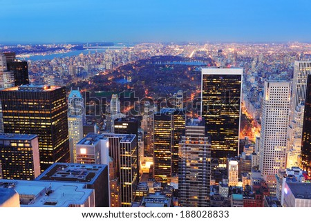 New York City skyline aerial view at dusk with central park and skyscrapers of midtown Manhattan lit by lights. - stock photo