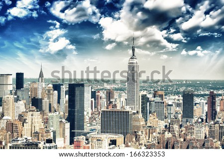 New York City skyline aerial view at sunset with colorful cloud and skyscrapers of midtown Manhattan - stock photo