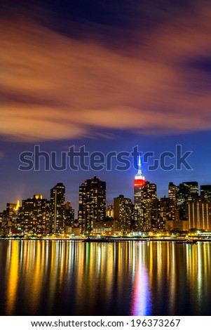 New York City skyline at night. View from Long Island City. Urban living concept - stock photo