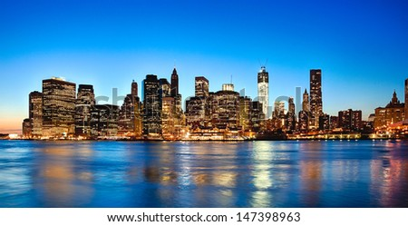 New York City skyline at twilight w the Freedom tower - stock photo