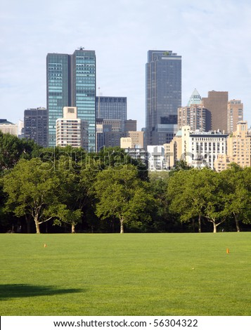 New York City skyscrapers seen across the Sheep's Meadow, Central Park; in vertical orientation - stock photo