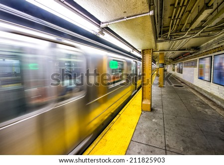 New York City subway train speeding up. - stock photo