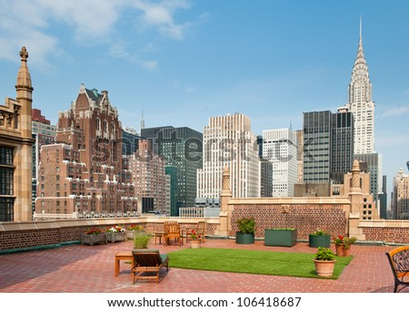 New York City terrace over Manhattan skyline view with Chrysler building in the background. - stock photo