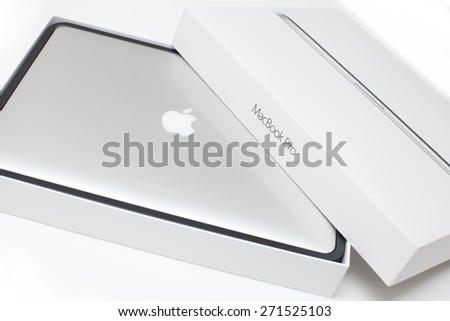"""New York City, U.S,A - April 14, 2015: Apple 15.4"""" MacBook Pro Notebook Computer with Retina Display on the white surface. It is a laptop computer that produced by Apple Inc. - stock photo"""