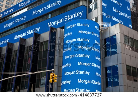 New York City, United States, - 31 March 2016 - Morgan Stanley Billboards on Times Square with traffic light in front - stock photo