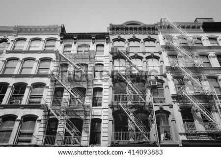 New York City, United States - old residential buildings in Midtown Manhattan. Black and white vintage style. - stock photo