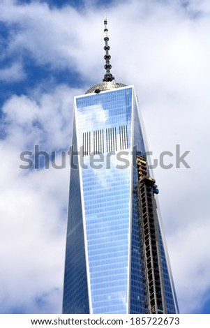 NEW YORK CITY, USA - April 5, 2014: Construction continues on One World Trade Center as the landmark building nears completion in Lower Manhattan  - stock photo