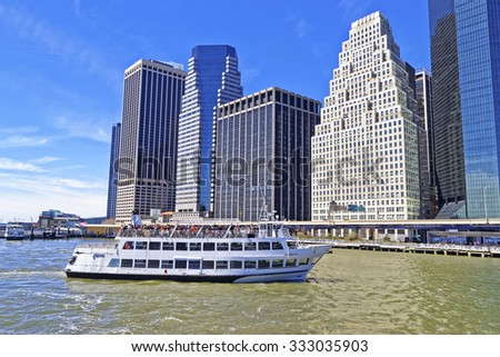 NEW YORK CITY, USA - APRIL 25, 2015: East River ferry boat in front of the majestic Lower Manhattan buildings on April 25, 2015. New York City, USA  - stock photo