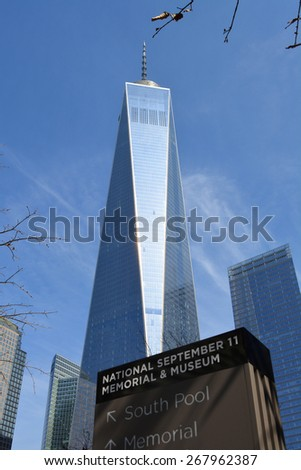 New York City, USA - April 5, 2015: Sign for the National 9/11 memorial and the newly opened World Trade Center Tower One at Ground Zero in New York City.  - stock photo