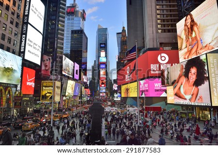 NEW YORK CITY, USA- April, 28. 2015: Times Square, with Broadway Theaters and animated LED signs, is a symbol of New York City and the United States, , Manhattan, New York City.  - stock photo