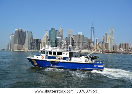 New York City, USA - August 16, 2015: NYPD boat after responding to an emergency on the East River in New York City. - stock photo
