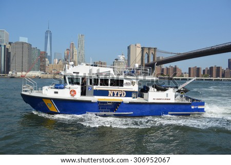 New York City, USA - August 16, 2015: NYPD boat responding to an emergency on the East River in New York City. - stock photo