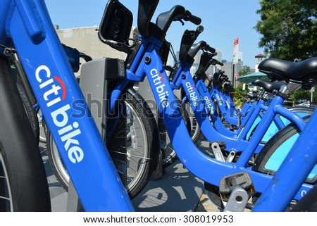 New York City, USA - August 16, 2015: Row of Citi Bikes waiting to be rented in Brooklyn Heights in New York City. - stock photo