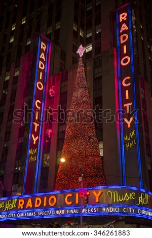 NEW YORK CITY, USA - DECEMBER 27, 2014: Christmas tree decorates the facade of the Radio City Music Hall, the iconic entertainment center at Rockefeller Center. - stock photo