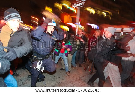 NEW YORK CITY, USA - DECEMBER 17 2011: Occupy Wall Street, protesting financial malfeasance, marked its 90 day anniversary with marches in Manhattan. Clashing with NYPD in Midtown Manhattan - stock photo