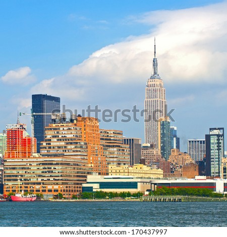 New York CIty, USA downtown buildings ona beautiful day with blue sky - stock photo