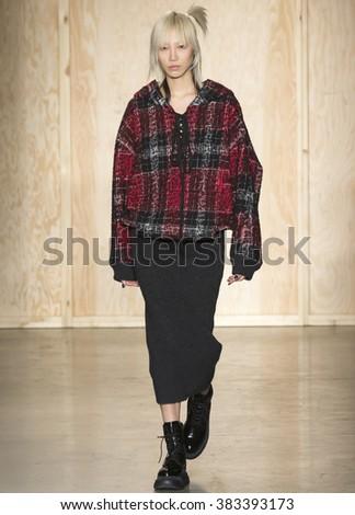 New York City, USA - February 17, 2016: Soo Joo Park walks the runway during the DKNY Women's show as a part of Fall 2016 New York Fashion Week at Skylight Modern - stock photo