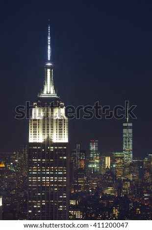 New York City, USA - July 12, 2015: Empire State Building and Manhattan Cityscape by night with Freedom Tower on background. The Empire State Building is the American cultural icon in New York City. - stock photo