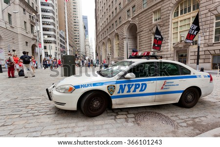 NEW YORK CITY , USA - JULY 07, 2015: NYPD car in Manhattan, financial district; established in 1845, NYPD is the largest municipal police force in the United States. - stock photo