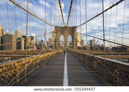 New York City, USA, - July. 11. 2015: Runners commuting to Manhattan over Brooklyn Bridge. New York, USA - stock photo