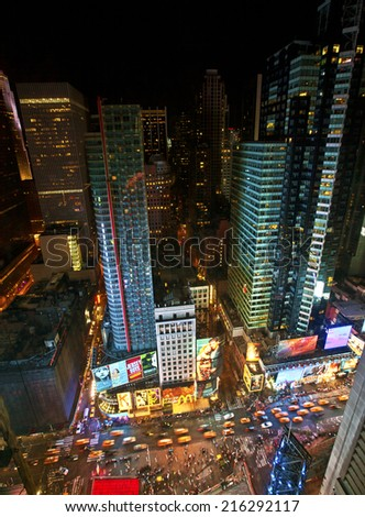 NEW YORK CITY, USA - JUNE 29th, 2014: Aerial view of Times Square the popular New Year's Eve destination with crowds and taxi cabs in motion in New York City  - stock photo
