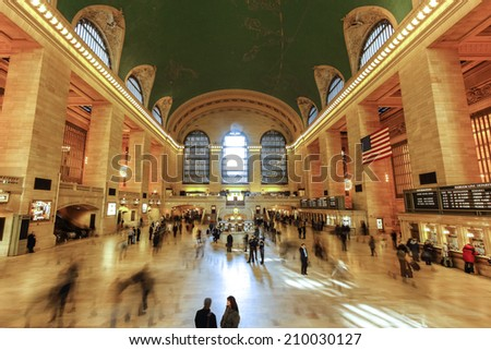 NEW YORK CITY, USA - MARCH 03, 2011: Interior of Grand Central Station in the rush hour with police officers and passengers. - stock photo