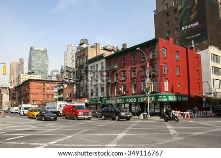 NEW YORK CITY, USA - MARCH 17 : Intersection of 9th avenue and west 36th street with residential buildings and traffic in Midtown Manhattan on March 17th, 2005 in New York City, USA. - stock photo