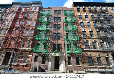 New York City, USA - March 23, 2013: Old building with fire escape, New York City, USA - stock photo