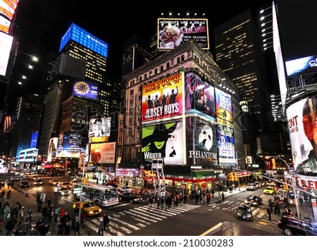 NEW YORK CITY, USA - MARCH 03, 2011: Times Square at night with Broadway Theaters and animated LED signs, symbol of New York City and the United States. - stock photo