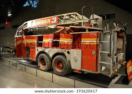 NEW YORK CITY, USA - May 17, 2014: Fire Engine destroyed in attacks on the Twin Towers at the National 9/11 Memorial Museum at Ground Zero in Lower Manhattan.  - stock photo