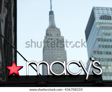 New York City, USA - May 28, 2016: Historic macy's store signage in front of the Empire State Building in Midtown Manhattan, New York - stock photo