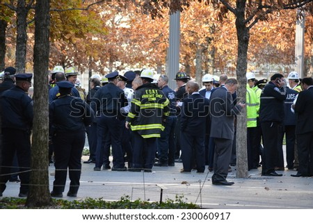 New York City, USA - November 12, 2014: Emergency workers gathered below Word Trade Center Tower One because of a collapsed scaffolding dangling from the building  in New York City.  - stock photo