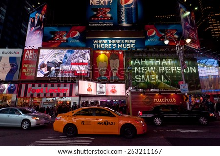 NEW YORK CITY, USA - NOVEMBER 20: Illuminated facades of Broadway with busy traffic and commercial atmosphere at November 20, 2011 near Times Square in Midtown Manhattan is a symbol of New York City. - stock photo