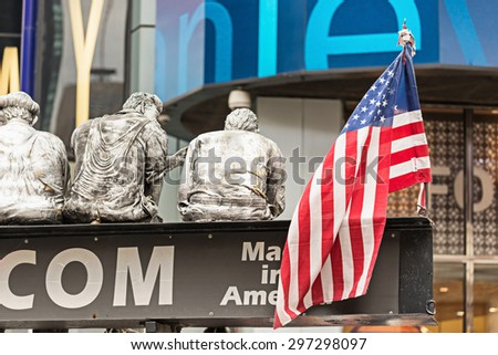 NEW YORK CITY, USA - NOVEMBER 16, 2014 : Part of reproduction statue of famous Lunch atop skyscraper or New York construction workers picture with an American Flag that writes made in America in NYC. - stock photo