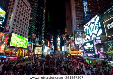 NEW YORK CITY, USA - NOVEMBER 18: People at Times Square in New York at night at November 18, 2011.  - stock photo