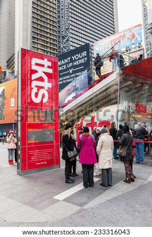 NEW YORK CITY, USA - NOVEMBER 20, 2014 : People looking for shows in TKTS discount ticket booth for Broadway shows of Theatre Devolopment Fund in Times Square New York City. - stock photo