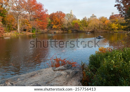 NEW YORK CITY, USA - NOVEMBER 14: People row in recreational boats on a lake in Central Park at November 14, 2011. - stock photo