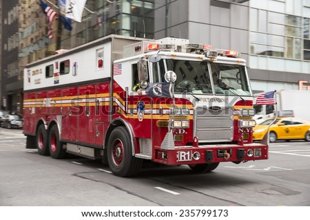 New York City, USA - November 5: View of a FDNY truck in New York City, USA on November 5, 2014. FDNY is the largest combined Fire and EMS provider in the world. - stock photo