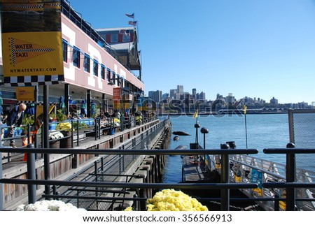 NEW YORK CITY, USA - Oct 26, 2008: Pier and East River NYC situated on one of the world's largest natural harbors with five boroughs - Brooklyn, Queens, Manhattan, the Bronx, Staten Island - stock photo
