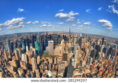New York City, USA - October 8: The skyline of New York City through the fisheye lens in HDR as viewed from the Empire State Building in Manhattan on the Fifth Avenue. October 8, 2014 in NYC, USA - stock photo