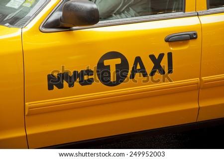 NEW YORK CITY, USA - SEPTEMBER 7: Logo of NYC Taxi on a yellow cab. New York City, USA sept 7 2011 - stock photo