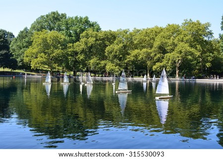 New York City, USA - September 7, 2015: Model sailboats on the Water Conservatory in Central Park in New York City. - stock photo