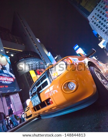 NEW YORK CITY, USA-SEPTEMBER 21: Times Square, featured with Theaters, Taxi Cabs, Luxury Limousines and animated LED signs, is a symbol of New York City. Taken in New York City on September 21, 2012 - stock photo