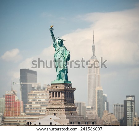 New York City, USA   skyline panorama with landmark buildings and statue of liberty - stock photo